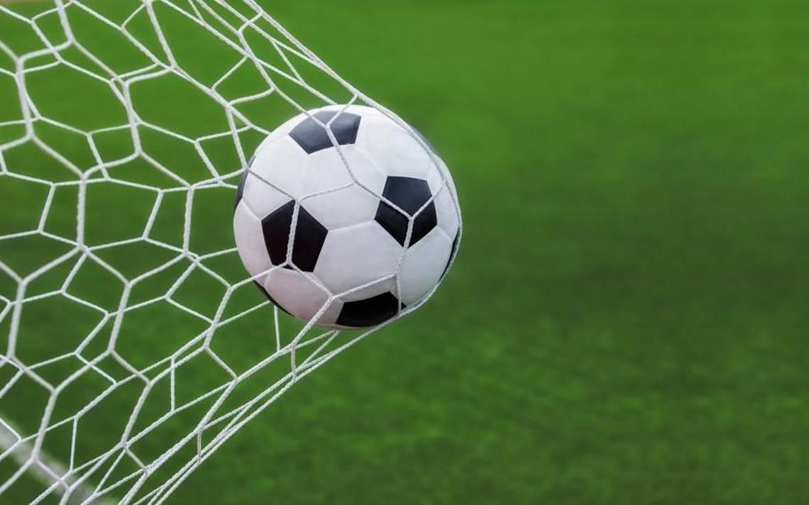 soccer ball going into goal